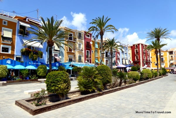 Colorful houses line the promenade overlooking the beach in Villajoyosa