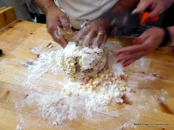 Kneading the pancetta and pecorino into the dough for snail-shaped lumachelle
