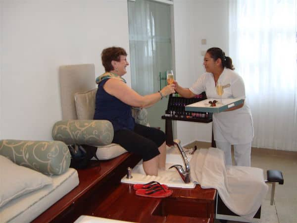 Sandra Nowlan enjoys champagne with her pedicure.