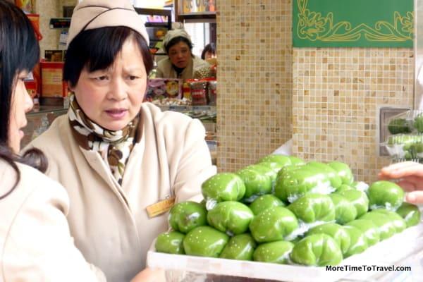 Vendor selling qingtuan, green dumplings for Tomb Sweeping Day on Nanjing Road in Shanghai