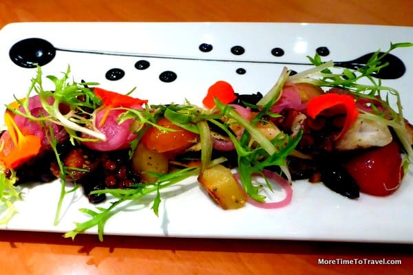 Grilled octopus, taggiasca olives, smoked fingerling potatoes, squid ink vinaigrette