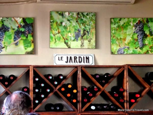 Wine wall in the bar room at Le Jardin
