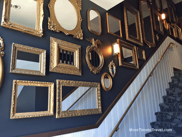 Beautiful gold-framed mirrors line the stairs to the second floor.