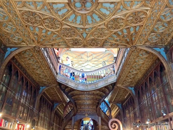 Intricately painted ceiling at Livraria Lello