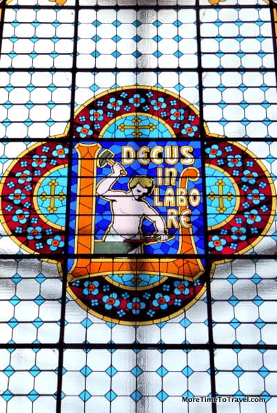 Stained glass skylight with the store's motto