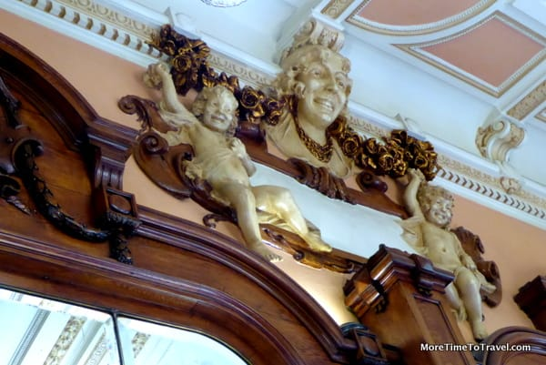 Gilded wall decor below crown molding at Majestic Cafe