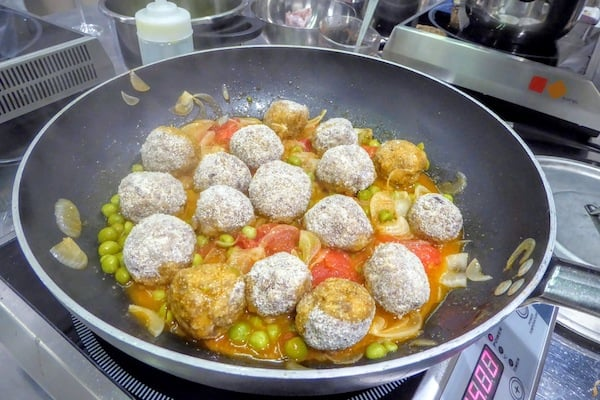 Polpette (meatballs) sizzling in the pan (Credit: Jerome Levine)