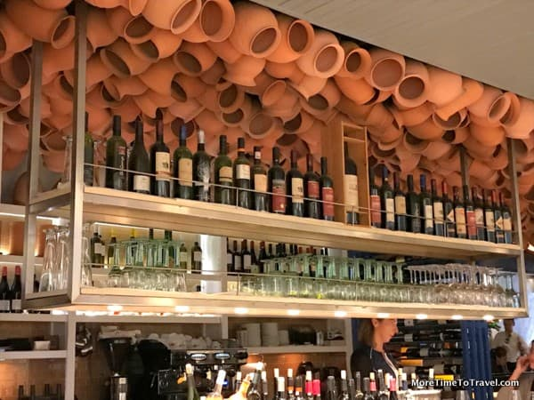 Hundreds of terra cotta pots dangle from the ceiling at Pylos Restaurant in the East Village
