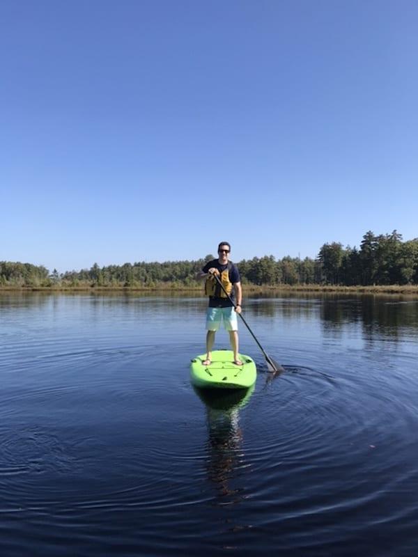 Jeremy enjoying standup paddle boarding on the lake