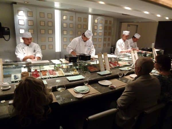 Busy chefs at Silk Road sushi bar on Crystal Serenity