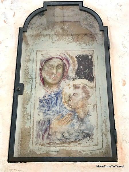 A frescoed niche on a street in Galatina