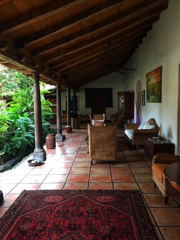 An inner courtyard filled with greenery offers an oasis to tired travelers