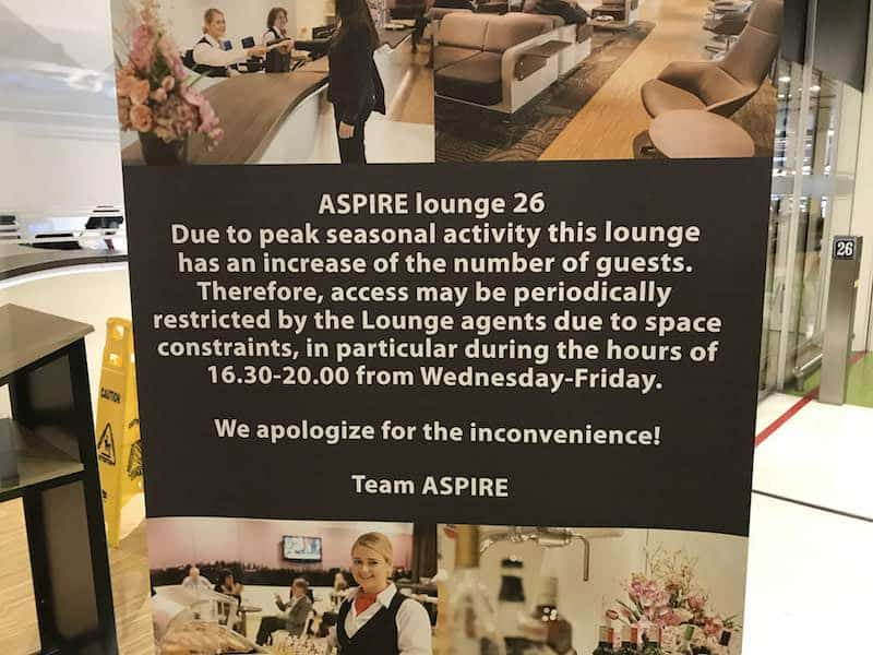 Warning sign outside the door of Aspire Lounge 26
