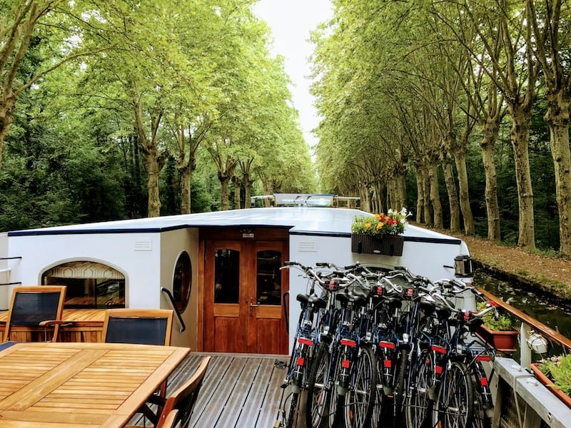 What To Pack For a Barge Cruise: Bicycles on a barge on a canal in Nordhouse, France