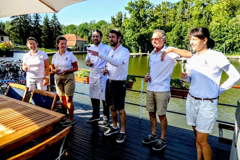 All crew on deck to welcome guests onboard with a champagne toast