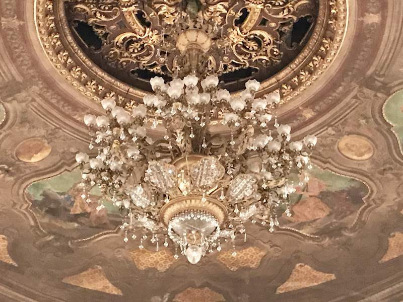 The elegant chandelier, once lit with candles, can be raised and lowered