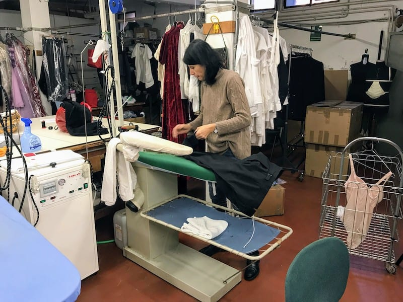 A seamstress at work in the costume department (Credit: Irene S. Levine)