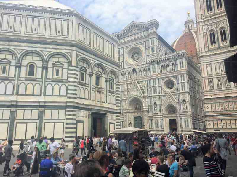 Crowded street in front of Cattedrale di Santa Maria del Fiore in Florence
