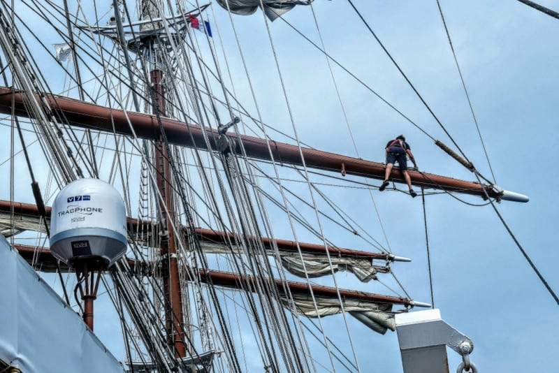 A crew member atop the mast on Sea Cloud