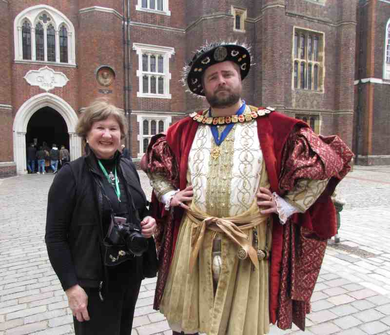"On a Tauck small ship, Sandra with ""Henry VIII"" at Hampton Court Palace"
