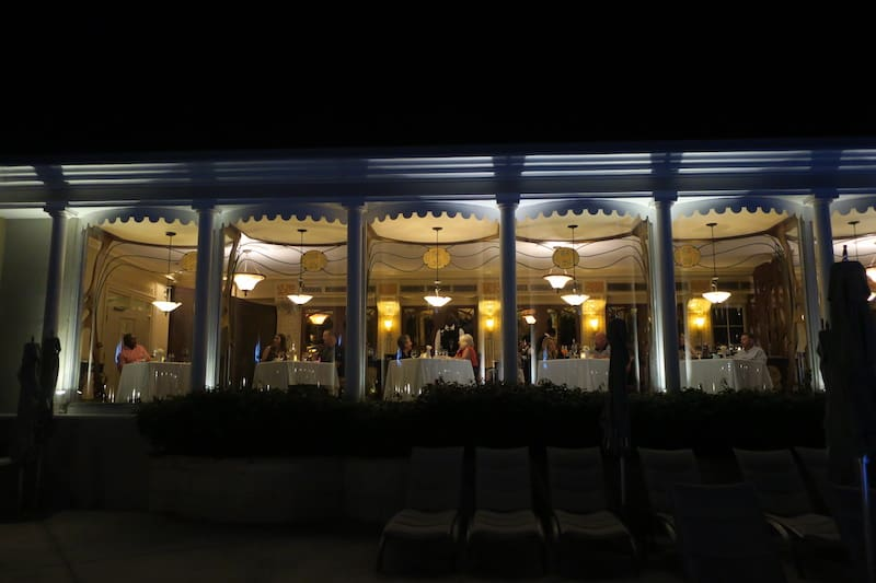 The elegant high curved windows of Baccarat Restaurant at evening