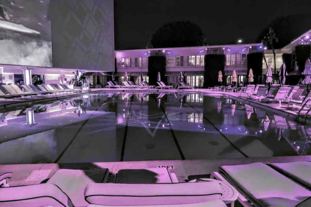The Olympic-size Aqua Star Pool at the Beverly Hilton lit a night - could be (and has been ) a movie set