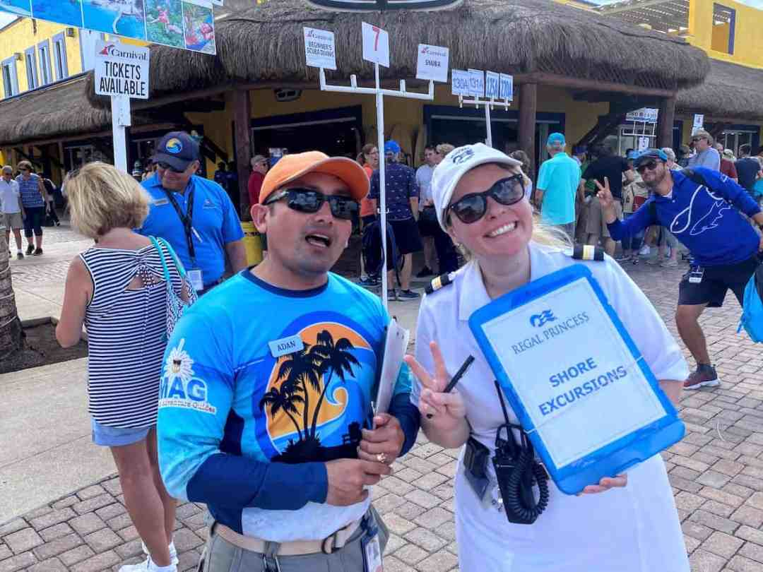 Vendors at Puerto Maya pier pitching shore excursions