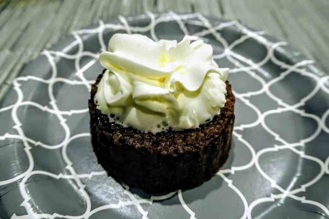 Embellishing the chef's dessert with a dollop of whipped cream
