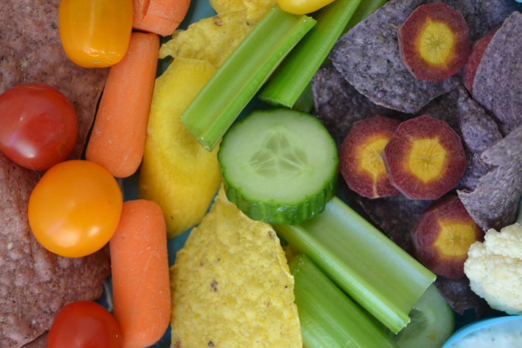 Veggies in rainbow order from red to purple to make a rainbow veggie platter