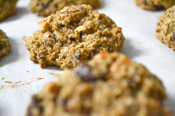 Healthy banana cookies with large chocolate chips on a baking sheet lines with parchment paper