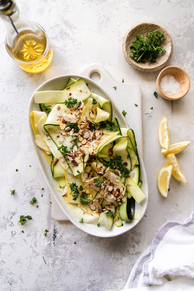 This Lemon Zucchini Ribbon Salad with Toasted Almonds is easy to whip up with fresh lemon and olive oil, making it my favorite Whole 30 and paleo side dish for summer!