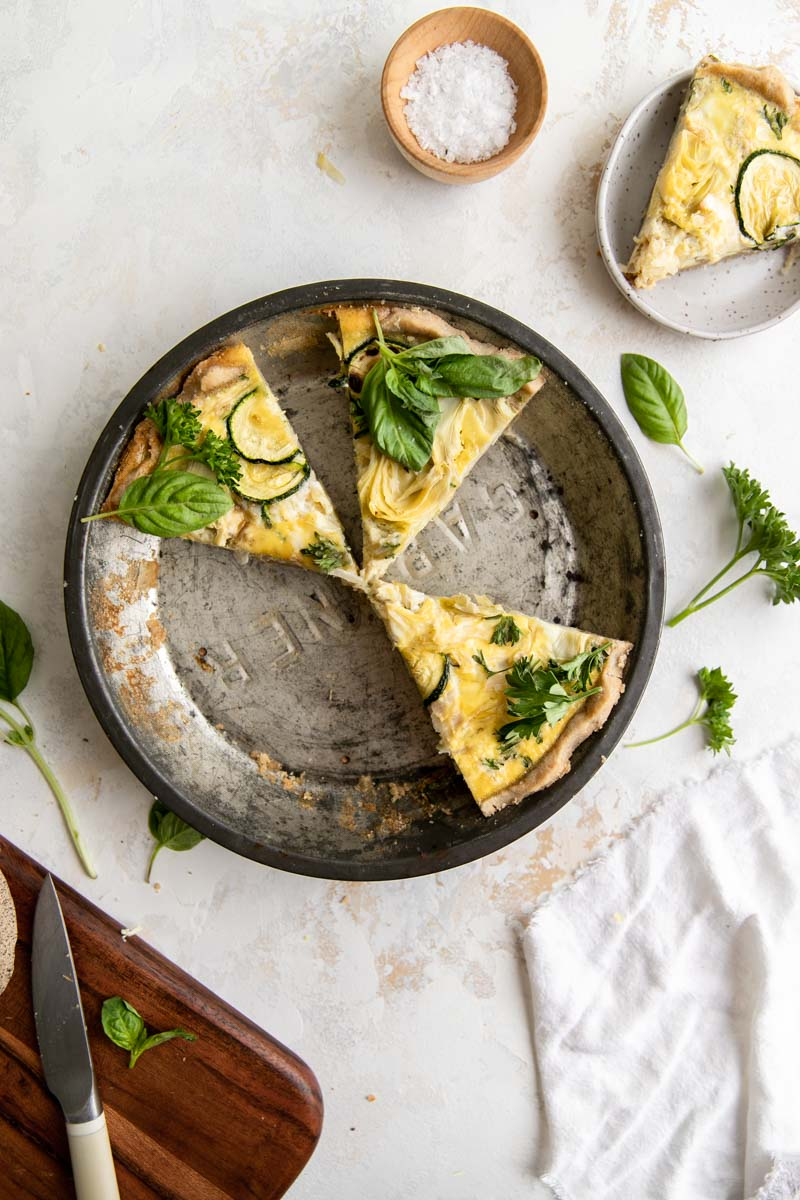 Creamy eggs swirled with crunchy sauerkraut and artichokes over a flaky grain-free crust make the perfect Gluten-Free Artichoke and Veggie Quiche for a flavorful, healthy brunch.