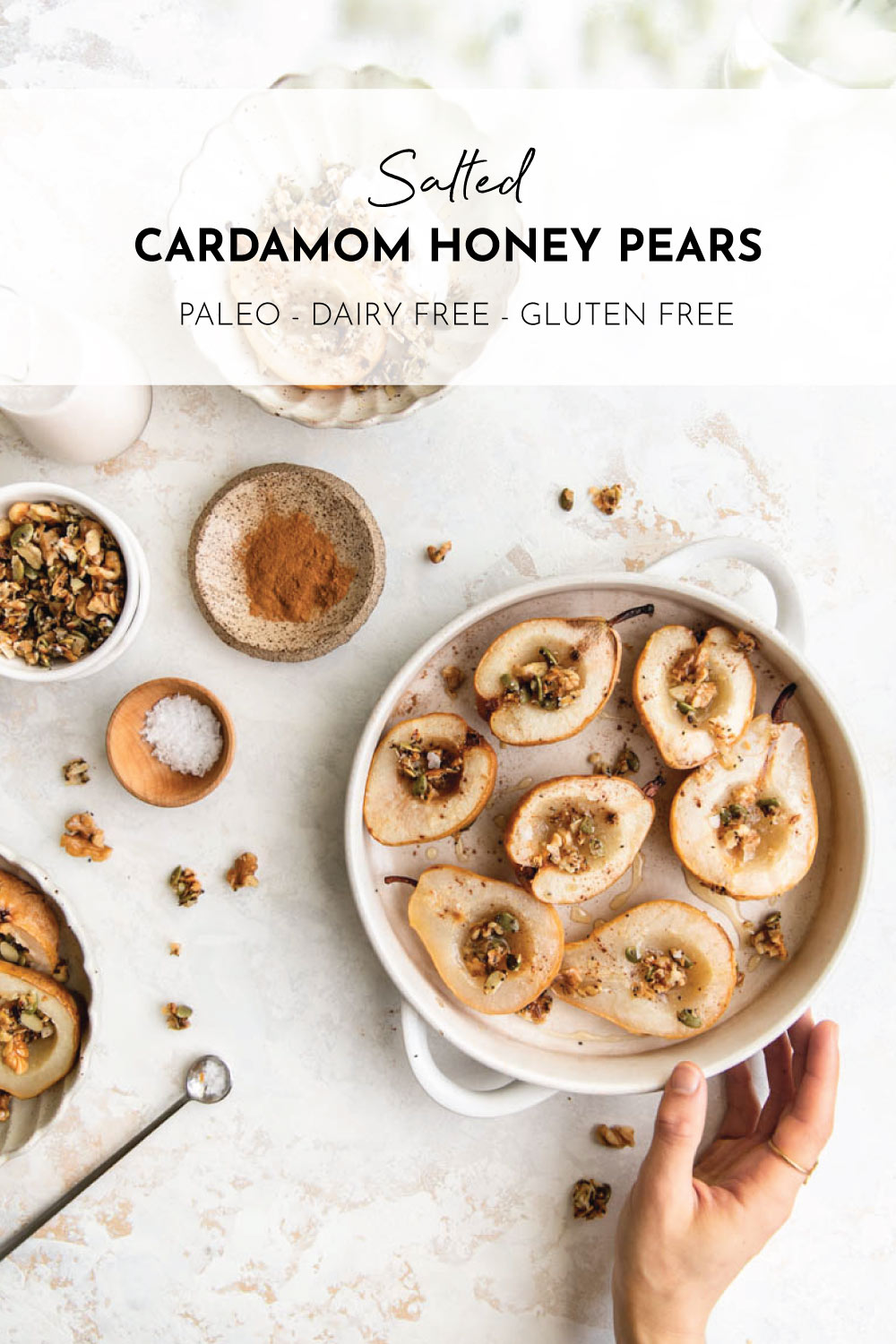 Cardamom and cinnamon dusted pears roasted and topped with a generous drizzle of honey and fancy sea salt --a healthy Paleo dessert!