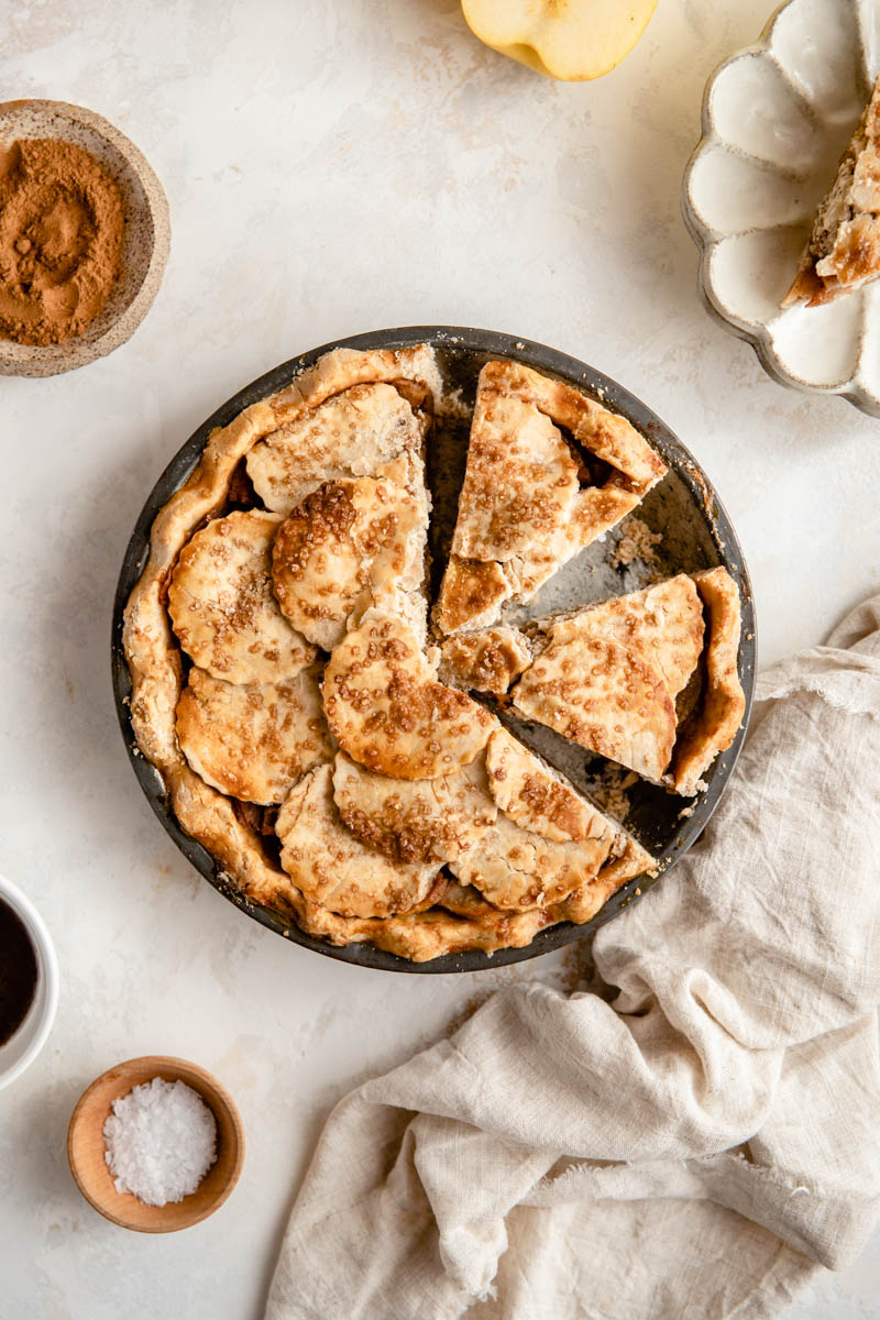 This Gluten-Free Salted Caramel Apple Pie is the perfect paleo pie to add to your Thanksgiving table! Cassava flour crust and all dairy-free ingredients make this an allergy-friendly apple pie everyone will love.