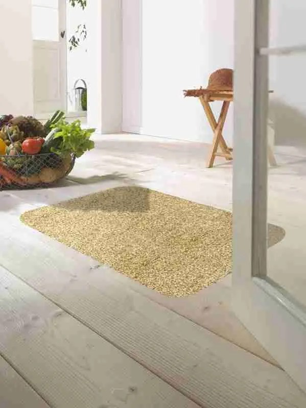 Morland cotton doormat in colour latte on on a wooden floor