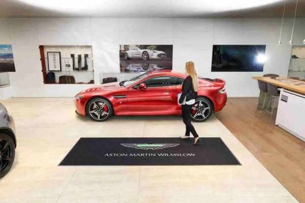 Large logo door mat in car showroom