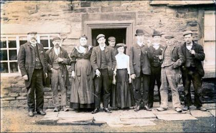 Group of People outside a cottage