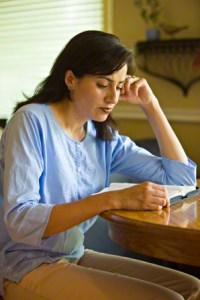 Mormon woman studying scriptures