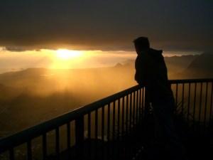Peson pondering at sunrise