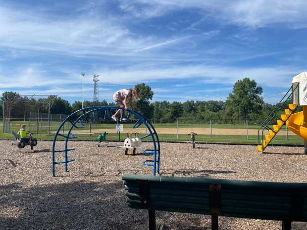 Children play on a playground at St. Mary Parish in Elyria.