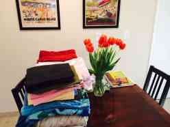 towels and sheets on kitchen table