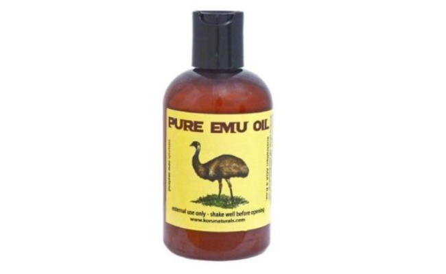 Applying emu oil on frizzy hair