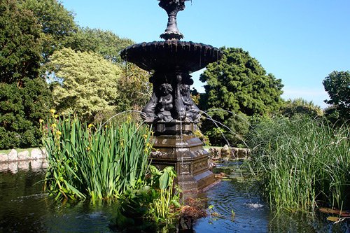 The cast iron fountain in Morrab Gardens is an elaborate design consisting of a pedestal with dolphins and cherubs riding tortoises.