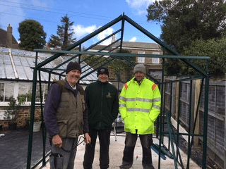 Joe and the builders take a break from putting up the new greenhouse