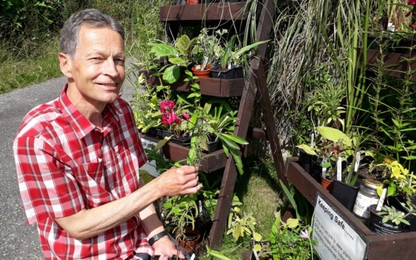 Martin tending to his plant sales stands at Bleujyowa – Curious Plants