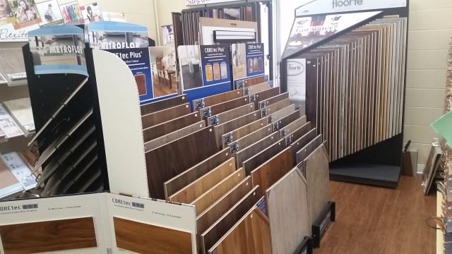 Racks of options for our luxury vinyl tile in Staunton, VA