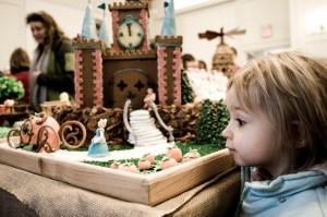 Young girl looking at handmade castle display