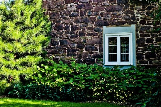 side of a stone bar with blue wood framed window