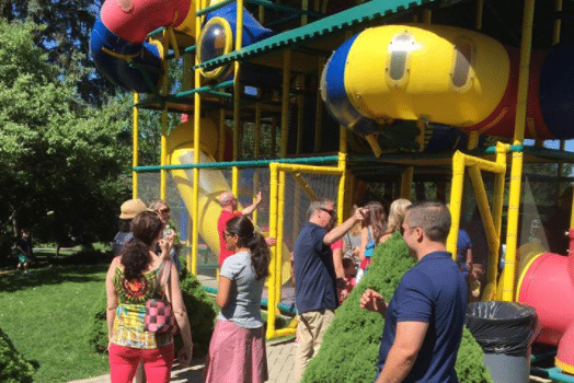 families playing at a playground