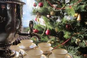 Christmas tree next to tea cups